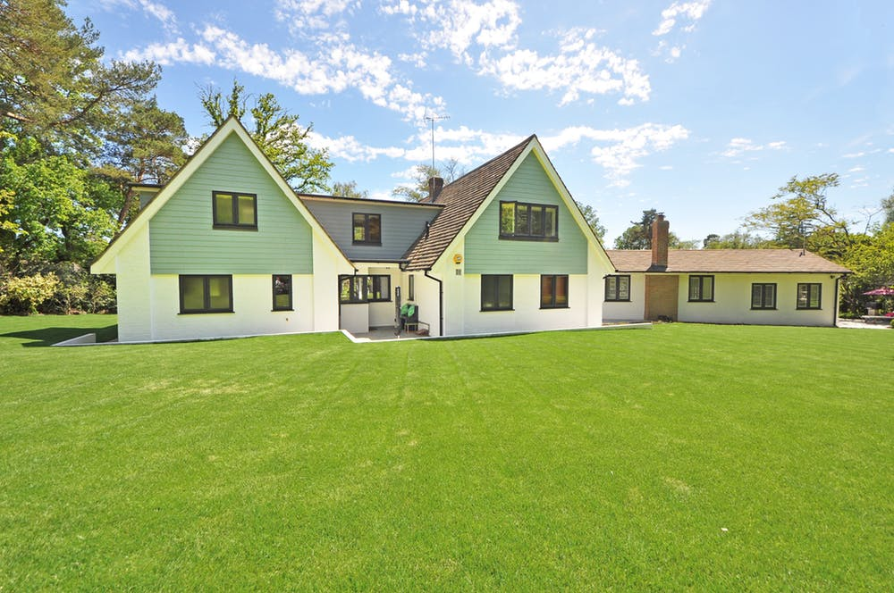 Home surrounded with artificial grass